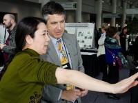 Image of two indviduals at the poster session at the annual conference