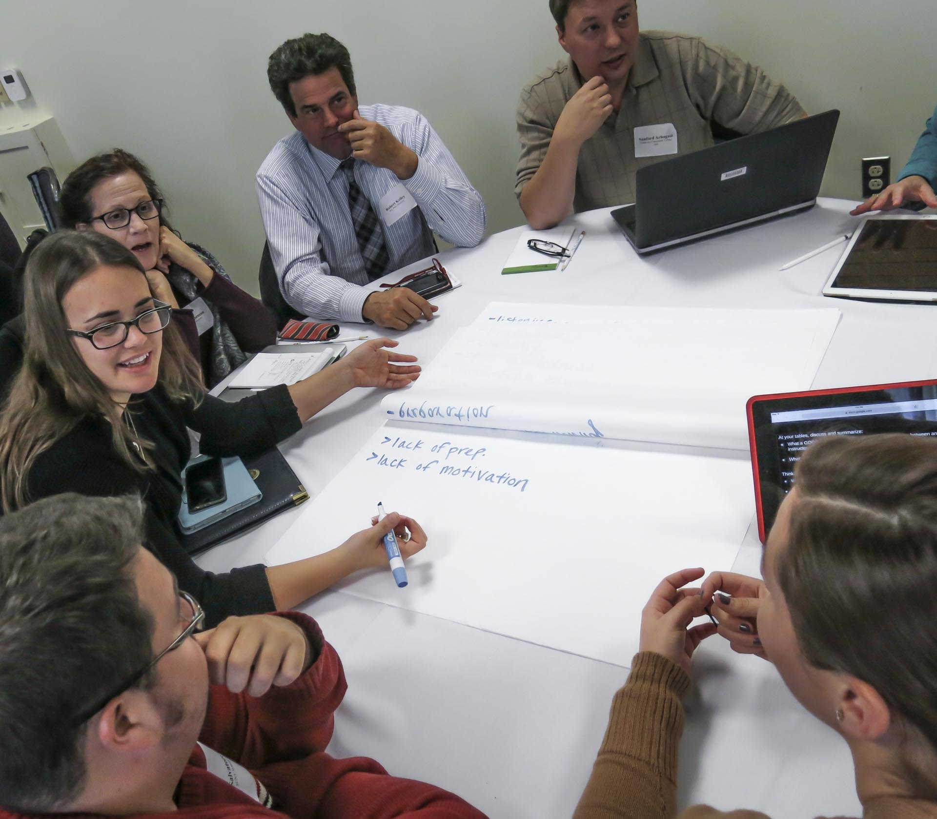 Participants collaborating at table
